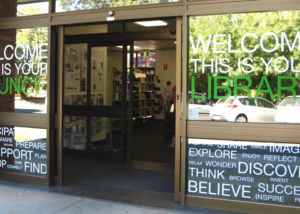 Creative self-adhesive lettering on Library windows, library signage