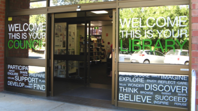 Creative self adhesive lettering on Library windows, library signage