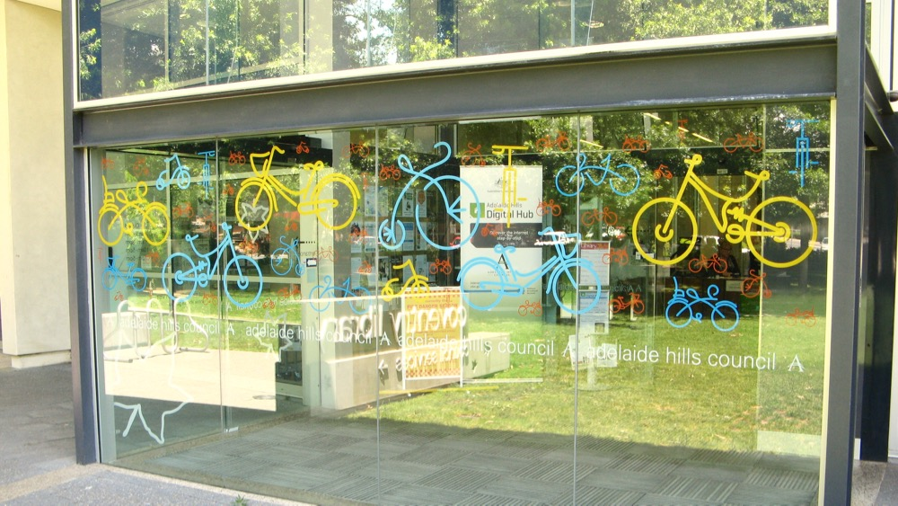 Tour Down Under bicycle decals on glass - Coventry Library Stirling - Adelaide Hills