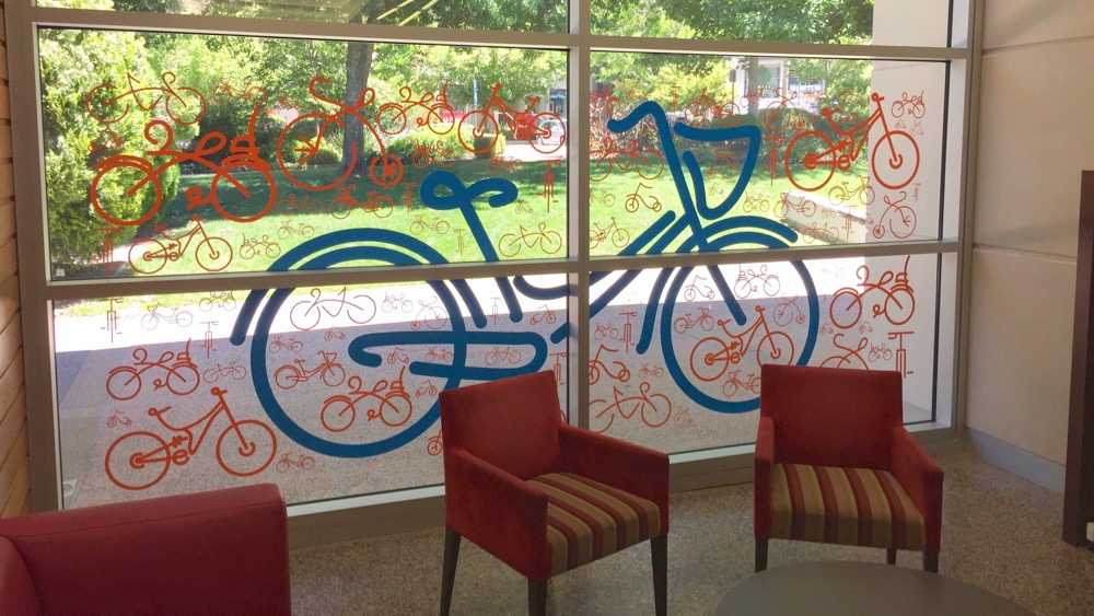 Tour Down Under decals on glass - Coventry Library Stirling - Adelaide Hills 2015