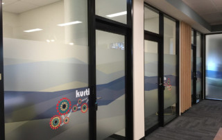 large scale collaborative project, custom privacy glazing and door signage for Housing SA Elizabeth Offices