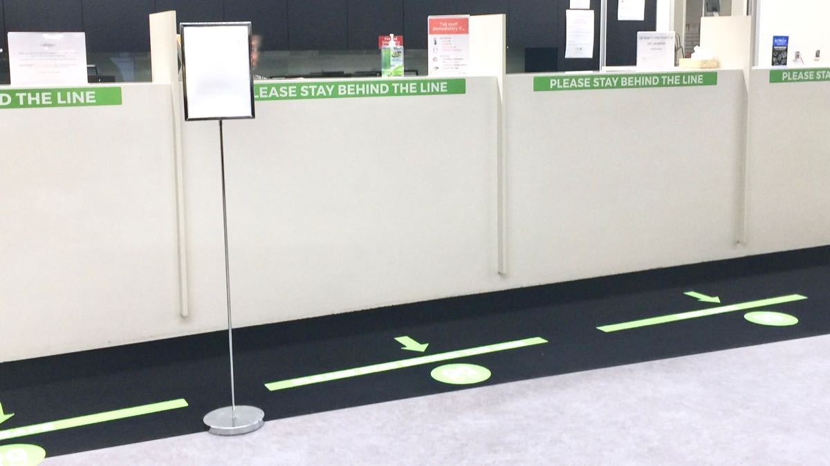 social distancing signage was installed on reception counter and carpet at the Summit Health Centre by WallsThatTalk