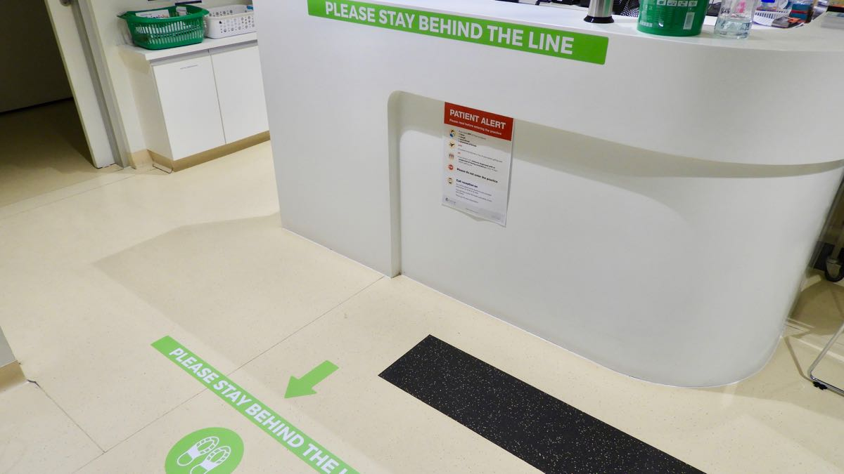 social distancing signage was installed at triage counter and vinyl floor at the Summit Health Centre by WallsThatTalk
